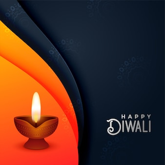 Creative diwali diya in orange and black colors