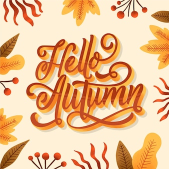 Creative hello autumn lettering with drawn leaves