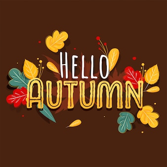 Creative hello autumn text with colorful leaves and berries decorated on brown background.
