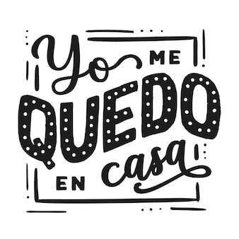 Creative i stay at home lettering in spanish with frame