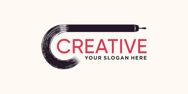 Creative ink hand drawn paint brush logo design with modern concept premium vector