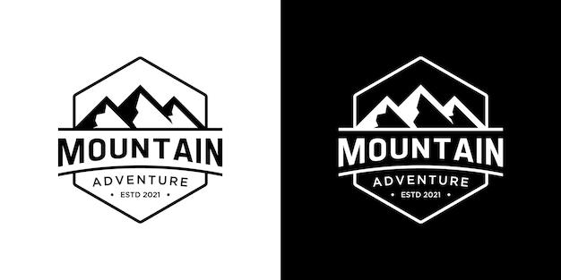 クリエイティブな山の冒険のロゴデザイン。アウトドア、キャンプ、遠征、旅行用のミニマルなビンテージ ロゴ。