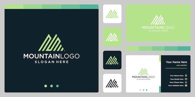 最初の文字nとsのロゴデザインでクリエイティブな山のロゴの抽象画。プレミアムベクトル