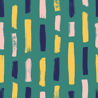Creative seamless pattern with vivid paint traces or smudges on green