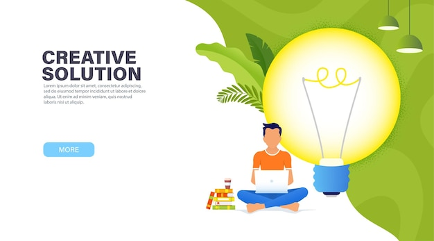 Creative solution concept. guy sitting in a lotus position with a laptop near the big glowing light bulb and working on a new creative idea.