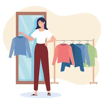 옷 매달려 크리 에이 티브 젊은 여성 패션 디자이너