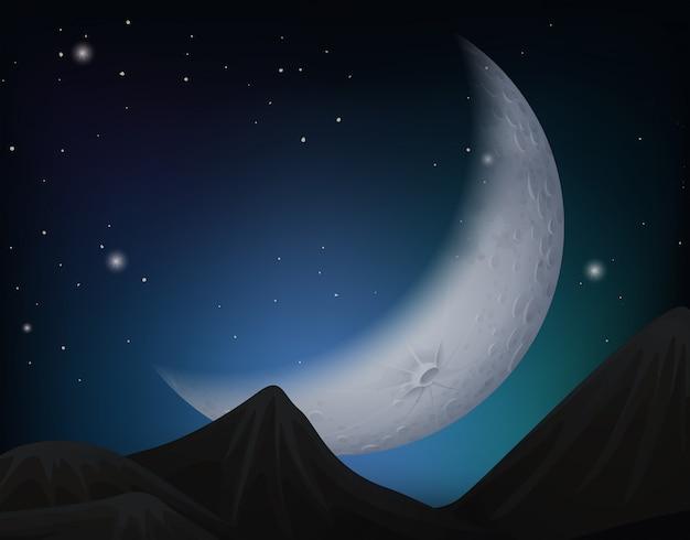 Cresent moon over hills scene