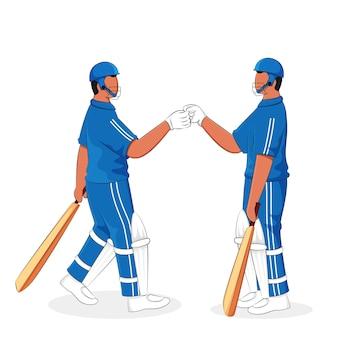 Cricket batsmen fist bumping each other on white background.