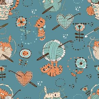かぎ針編み。ウールのボールと編み物のアクセサリーでかわいい猫とのシームレスなパターン。