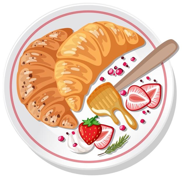 分離したプレートにイチゴとクリームをトッピングしたクロワッサン