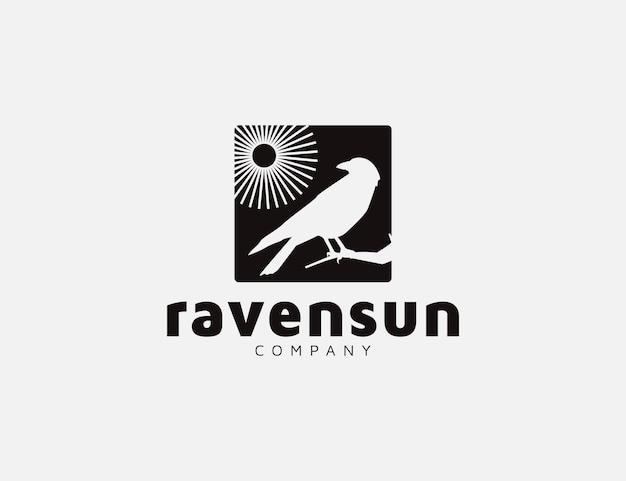 カラスの鳥と太陽のシルエットのロゴデザイン Premiumベクター