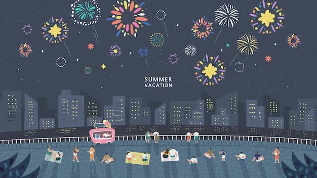 暗い夜の空に花火を表示し、都市の建物に対して休日を祝う人々の群衆