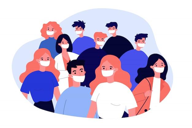 医療用フェイスマスクを着ている人々の群衆