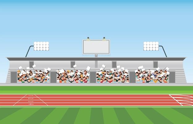 Crowd in stadium grandstand to cheering sport.