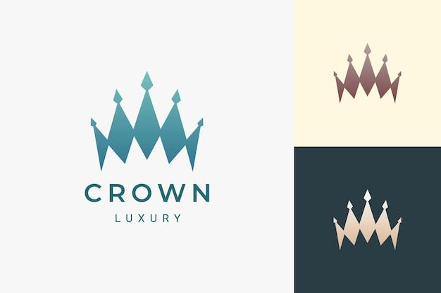 Логотип короны в роскошной и чистой форме представляет короля и королеву