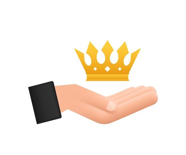 Корона короля висит над руками, изолированные на белом фоне золотая королевская икона