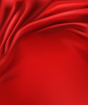しわくちゃと波状、豪華な赤い絹またはサテン生地の背景