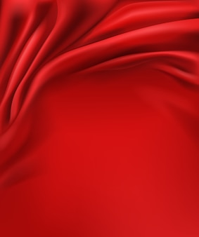 Crumpled and wavy, luxury red silk or satin fabric background