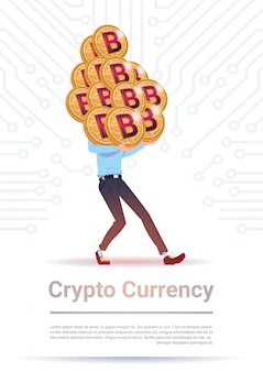 Crypto currency concept man holding stack of golden bitcoin over motherboard circuit background