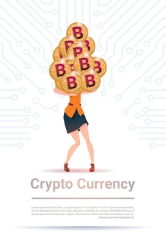 Crypto currency concept woman holding stack of golden bitcoin over motherboard circuit background