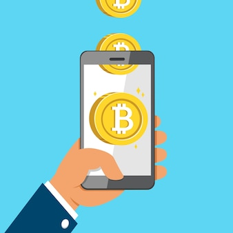 Cryptocurrency concept hand holding smartphone and earning money coins