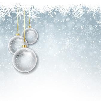 Хрустальные шары на фоне снега