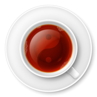 Cup of black tea with traditional chinese yin-yang symbol