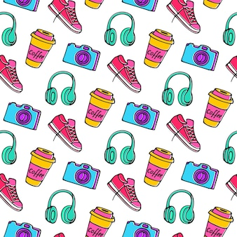 Cup of coffee to go, camera, sneakers and headphones seamless pattern hand drawing doodle.