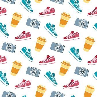 Cup of coffee to go, camera, sneakers seamless pattern hand drawing doodle.