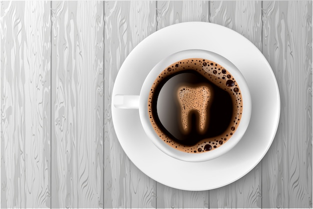 Cup of coffee with tooth from foam