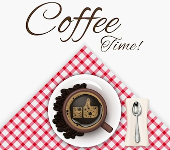 Cup of coffee with coffee beans and spoon on a tablecloth