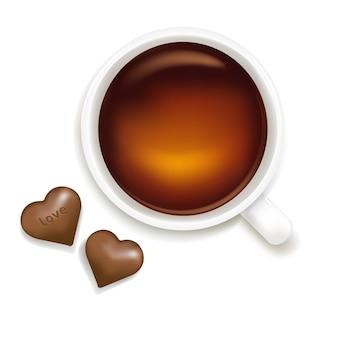 白い背景で隔離のチョコレートとお茶のカップ、