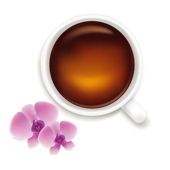 흰색 배경에 고립 된 난초와 차 한잔,