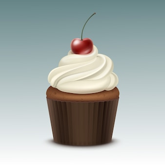 Cupcake with white whipped cream and cherry close up
