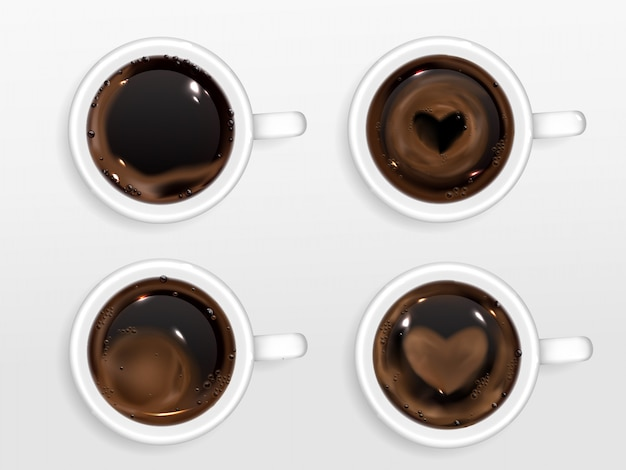 Cups of coffee with heart shape from cream foam