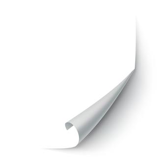 白で隔離されるカールした紙の角
