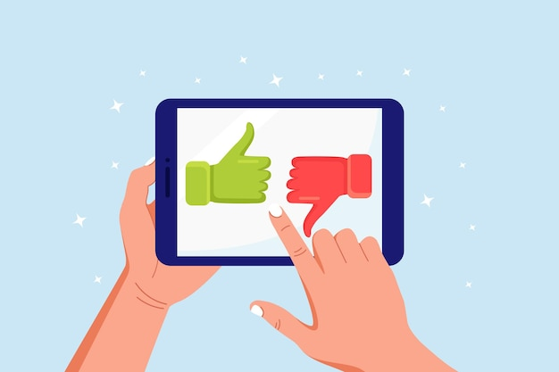 Customer feedback, rating and review concept. human hands holding tablet with like and dislike. thumb up and down on computer pc screen. blogging, online messaging, social network services