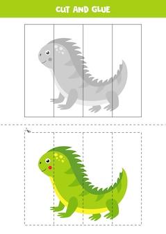かわいい漫画の緑のイグアナをカットして接着します。子供のための教育ゲーム。切ることを学ぶ。子供のためのパズル。