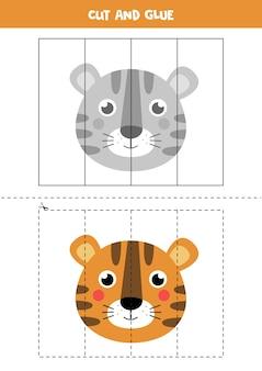 かわいい虎の顔をカットして接着します。子供のための教育ゲーム。切ることを学ぶ。子供のためのパズル。