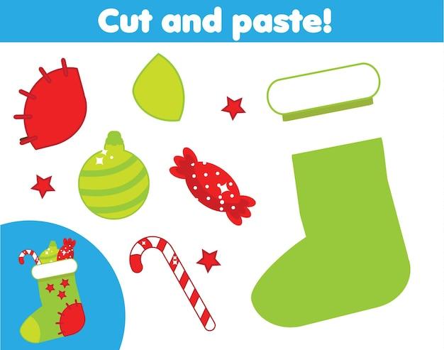잘라내기 및 붙여넣기 어린이 교육 게임. 종이 자르기 활동. 풀과 가위로 크리스마스 스타킹을 만드세요. diy 워크시트