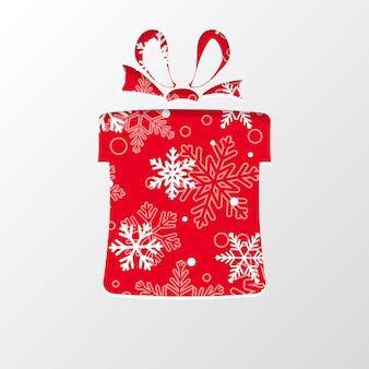 빨간색 배경에 하얀 눈송이가 있는 크리스마스 선물 상자 모양의 종이를 잘라냅니다.