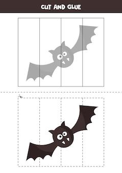 かわいいハロウィンのバットの絵を切り取り、パーツごとに貼り付けます。子供のための教育的論理ゲーム。未就学児のためのパズル。
