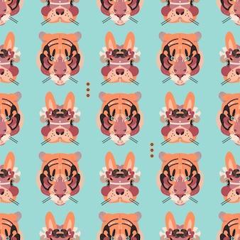 Cute adorable tiger and bunny faces in a seamless pattern
