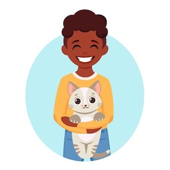 彼の手で猫を保持しているかわいいアフリカ系アメリカ人の少年