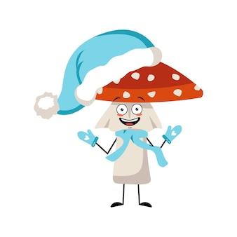 楽しい感情、笑顔、幸せな目、腕と脚を持つかわいいテングタケ属のキャラクター。優しい表情で森からベニテングタケを飛ばしてください。青いサンタの帽子、スカーフ、ミトンで新年あけましておめでとうございます