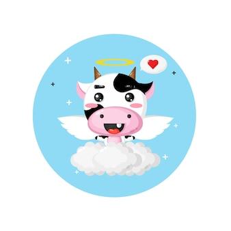 空を飛んでいるかわいい天使の牛