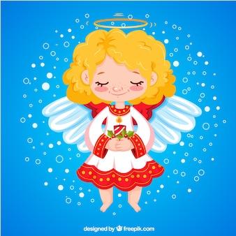 Ragazza angelo carina che tiene un regalo
