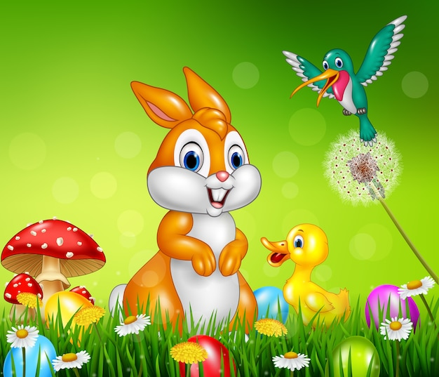 Cute animals easter eggs on green grass