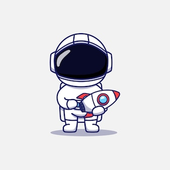 Милый космонавт, несущий модель ракеты