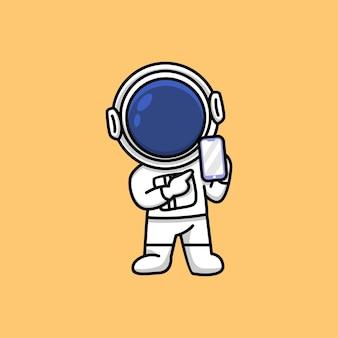 スマートフォンを表示し、その漫画イラストを指しているかわいい宇宙飛行士